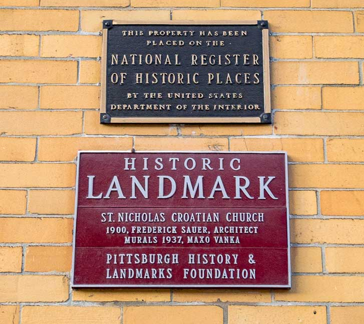 Sign reads: This Property has been placed on the National Register of Historic places