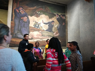 Students learn about the murals