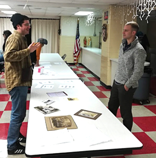Group discusses print outs for Save Maxo Vanka Education