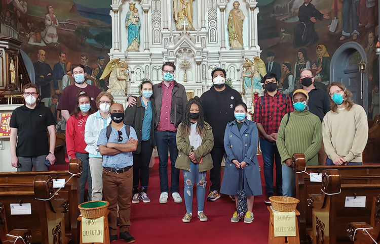 Masked group visiting the murals
